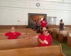 adults and children fellowship for vacation bible school in church pew
